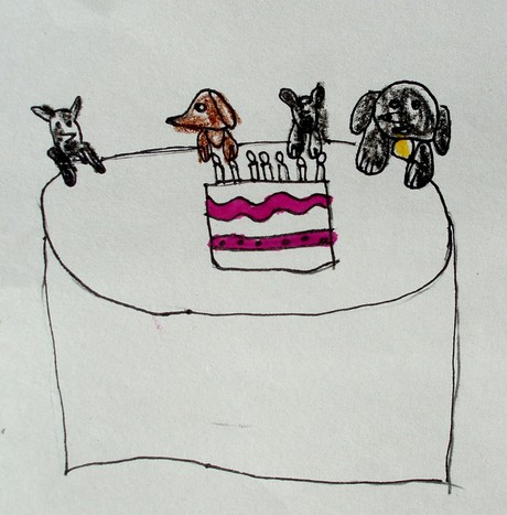 a drawing of dogs with a birthday cake
